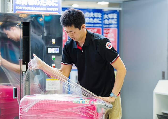 Baggage wrapping business image